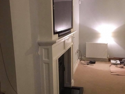 Retro fitted bespoke surround with enclosed TV and sound bar