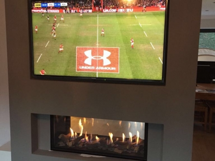 Double sided cassette gas fire with built in flush TV