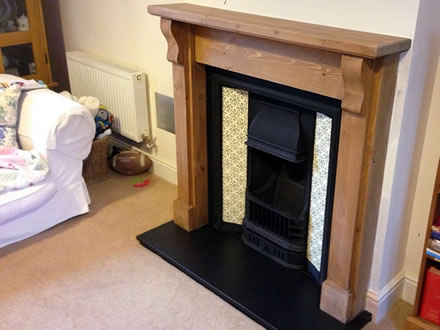 Open Gas Cast Iron Fire with Tiled Feature & Oak Mantle